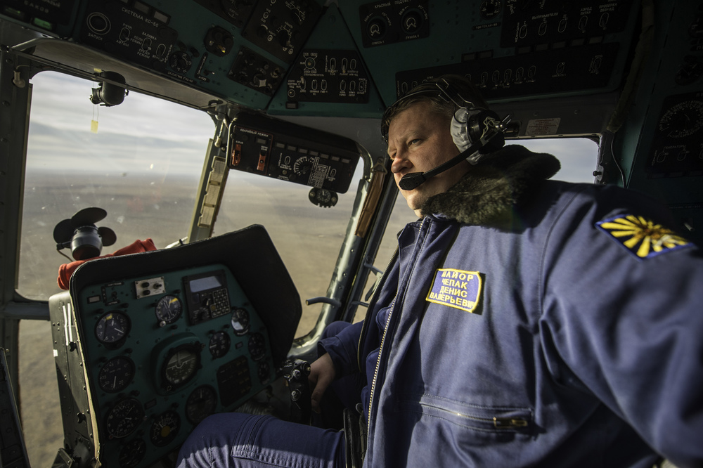 Major Dennis Valeriyavich Chepak, of Russian Search and Rescue, is seen in the cockpit of his helicopter en route to Zhezkazgan airport in Kazakhstan, Sunday, Nov. 10, 2013, a day ahead of the scheduled landing of the Soyuz TMA-09M spacecraft with Expedition 37 Commander Fyodor Yurchikhin of the Russian Federal Space Agency (Roscosmos), Flight Engineer Karen Nyberg of NASA and Flight Engineer Luca Parmitano of the European Space Agency. Yurchikhin, Nyberg and Parmitano are returning to Earth after five and a half months on the International Space Station. (NASA/Carla Cioffi)