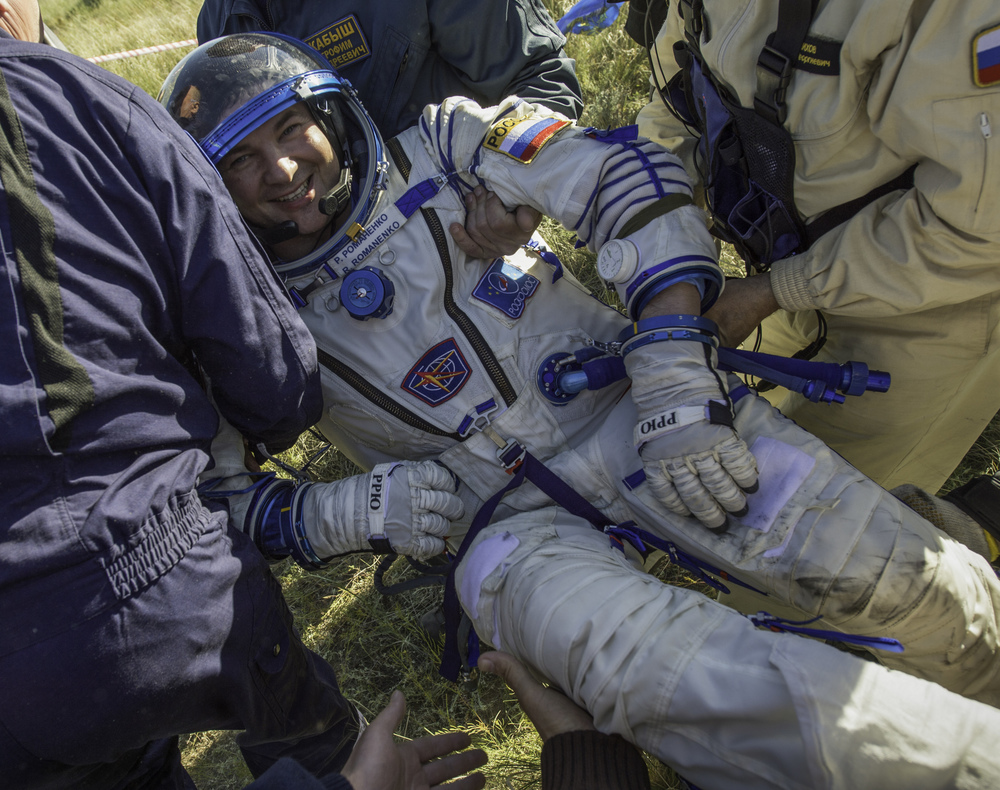 Expedition 35 Flight Engineer and Russian cosmonaut Roman Romanenko is seen smiling as he is carried after being extracted from the Soyuz TMA-07M spacecraft shortly after the capsule landed with Expedition 35 Commander Chris Hadfield of the Canadian Space Agency (CSA) and NASA Flight Engineer Tom Marshburn in a remote area outside of the town of Zhezkazgan, Kazakhstan on Tuesday, May 14, 2013. Romanenko, Hadfield and Marshburn are returning from five months onboard the International Space Station where they served as members of the Expedition 34 and 35 crews. (NASA/Carla Cioffi)