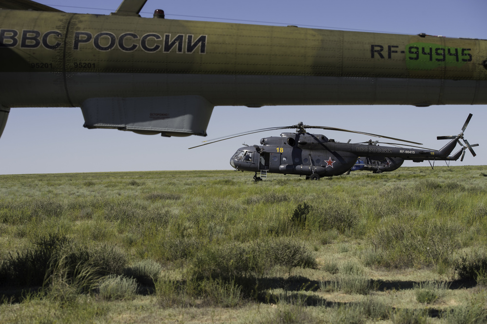 Russian Search and Rescue Helicopters are seen as they await departure from the landing zone in a remote area near the town of Zhezkazgan, Kazakhstan following the the landing of the Soyuz TMA-07M spacecraft on Tuesday, May 14, 2013. The Soyuz spacecraft delivered Expedition 35 Commander Chris Hadfield of the Canadian Space Agency (CSA), NASA Flight Engineer Tom Marshburn and Russian Flight Engineer Roman Romanenko after having spent five months onboard the International Space Station where they served as members of the Expedition 34 and 35 crews. (NASA/Carla Cioffi)