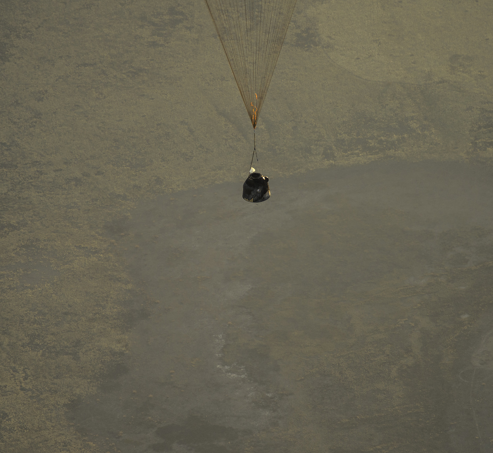 The Soyuz TMA-09M is seen moments before it lands southeast of the town of Zhezkazgan, Kazakhstan with the crew of Expedition 37, Monday, Nov. 11, 2013. Expedition 37 Commander Fyodor Yurchikhin of the Russian Federal Space Agency (Roscosmos), Flight Engineer Karen Nyberg of NASA and Flight Engineer Luca Parmitano of the European Space Agency are returning to Earth after five and a half months on the International Space Station. (NASA/Carla Cioffi)