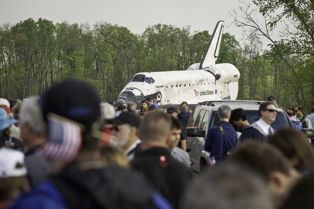 Space shuttle Discovery is rolled toward the transfer ceremony at the Steven F. Udvar-Hazy Center Thursday, April 19, 2012 in Chantilly, Va. Discovery will be permanently housed at the Udvar-Hazy Center, part of the Smithsonian Institution's Air and Space Museum. Discovery, the first orbiter retired from NASA's shuttle fleet, completed 39 missions, spent 365 days in space, orbited the Earth 5,830 times, and traveled 148,221,675 miles. NASA will transfer Discovery to the National Air and Space Museum to begin its new mission to commemorate past achievements in space and to educate and inspire future generations of explorers. (NASA/Carla Cioffi)