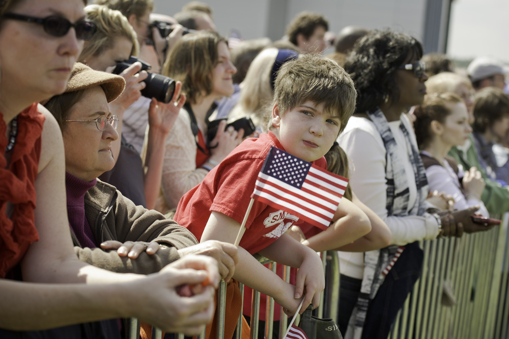 Spectators watch as space shuttle Discovery arrives the National Air and Space Museum's Steven F. Udvar-Hazy Center, Tuesday, April 17, 2012, in Chantilly, Va. Discovery, the first orbiter retired from NASA's shuttle fleet, completed 39 missions, spent 365 days in space, orbited the Earth 5,830 times, and traveled 148,221,675 miles. NASA will transfer Discovery to the National Air and Space Museum to begin its new mission to commemorate past achievements in space and to educate and inspire future generations of explorers. (NASA/Carla Cioffi)