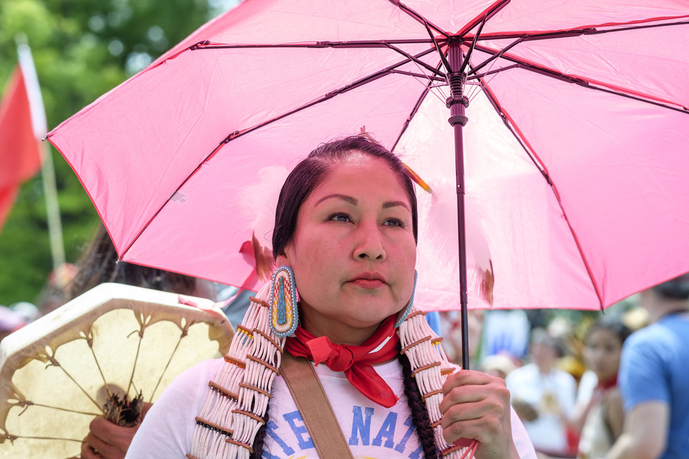 "Brenda Whitebull, from the Standing Rock Sioux Tribe, marches in the Protectors of Justice contingency in the frontline of the Peoples Climate March in Washington, DC on Saturday, April 29, 2017. When asked why she was attending the march she said, ""I'm here to continue to make a change, to fight for our rights as human beings. To fight for Unchi Maka, Grandmother Earth. She has a voice, and we are her human voice. We have to continue because she has a spirit, just like our water, our plants. Everybody has a spirit. Everything has a spirit on this land. And we have to remember that, and those spirits are what goes in to our bodies whether it be food or water."" The Peoples Climate March took place on the 100th day of Donald Trump's presidency. Marchers surrounded the White House in a silent sit-in to recognize the damage caused by the Trump administration over the last 100 days."