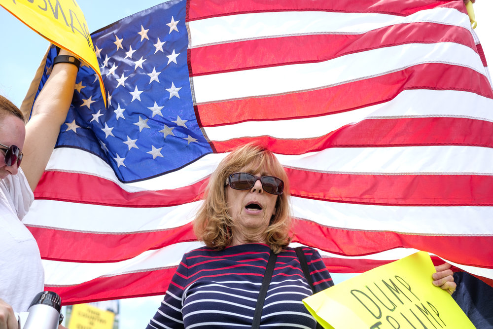 "Becky, from Maryland, chants in protest at the March for Truth DC rally held on the National Mall on Saturday, June 3, 2017 in Washington, DC. When asked why she attended the protest she said, ""I'm in support of this because I'm not in support of him. Or the GOP. They're traitors."" This was Becky's first protest. The aim of the protest is to raise the voices of the people and let elected leaders know that Americans want answers. Collectively people rise together and call for a fair and impartial investigation, for the pursuit of truth, and for the restoration of faith in the electoral system and the Office of the Presidency. The goals of the protest are four-fold: An independent commission must be established, and Congressional investigations should be properly resourced and pursued free of partisan interests; As much information should be made available to the public as possible, and as soon as possible; Congress should require Donald Trump to release his tax returns to clarify his business interests and obligations to any foreign entity; If crimes were committed or if collusion is discovered, it must be prosecuted."