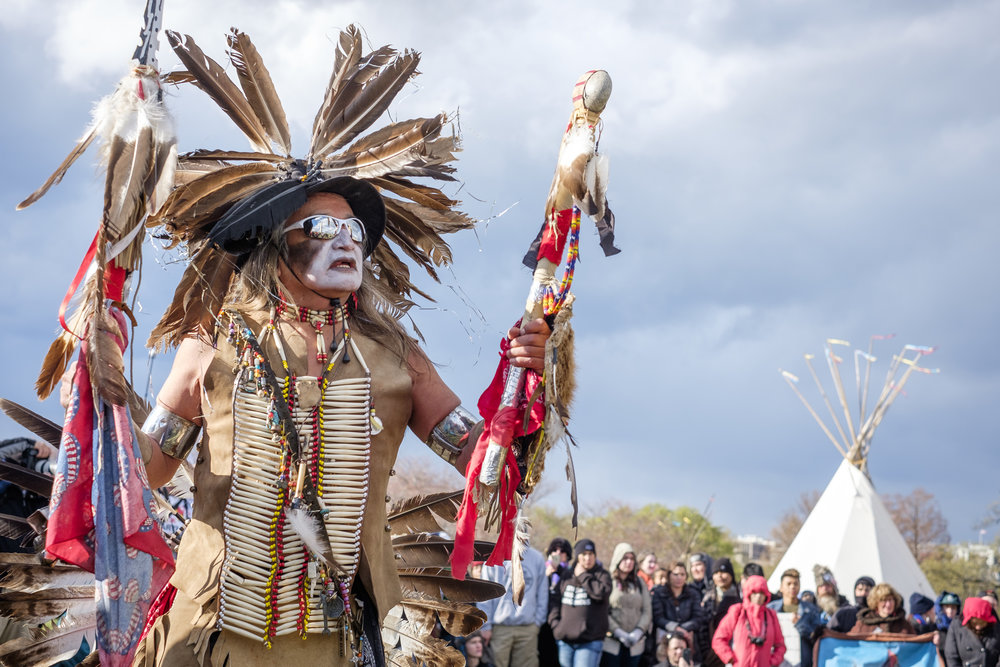 Phil Little Thunder, a traditional dancer and indigenous activist of the Rosebud Sioux Tribe, dances at the Tipi Camp near the Washington Monument following the Native Nations March in Washington, DC on Friday, March 10, 2017.