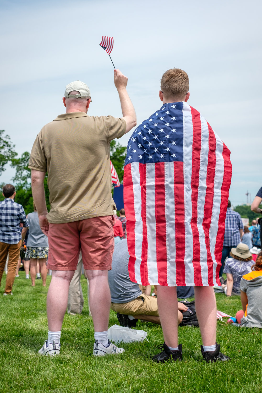"Joe Bates, left, and his son Matthew from Fairfax, VA are seen from behind at the March for Truth DC rally held on the National Mall on Saturday, June 3, 2017 in Washington, DC. ""I'm here because Trump is the most despicable president we've ever had in the history of the United States. And I think we the people need to show that we're not going to stand for it,"" offered Joe."