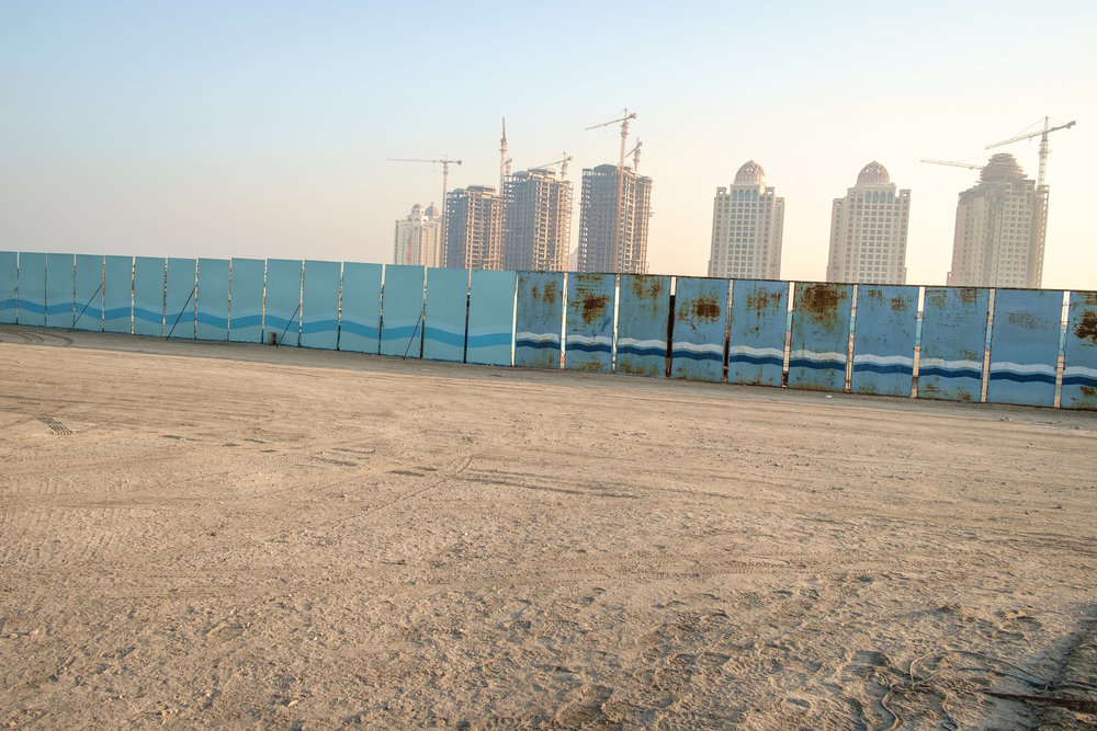 A construction scene on The Pearl with the Viva Bahriya Towers residential development in the background. The Pearl is an artificial island comprising of luxury residential estates and businesses. It is the first land in Qatar made available for ownership by foreign nationals.