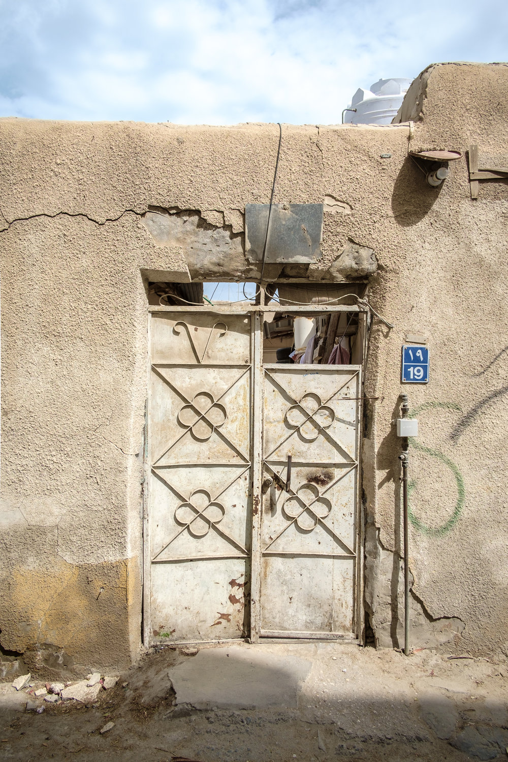 The door of a residential compound in the old Musheireb neighborhood of Doha. Much of this neighborhood has been torn down, and the residents forcibly removed, in order to build the New Msheireb development. Qatar is in a race to revitalize and modernize in time to host the 2022 FIFA World Cup.