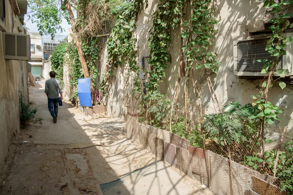 A scene of one of the back streets of the old Musheireb neighborhood in Doha. Much of this neighborhood has been torn down, and the residents forcibly removed, in order to build the New Msheireb development. Qatar is in a race to revitalize and modernize in time to host the 2022 FIFA World Cup.