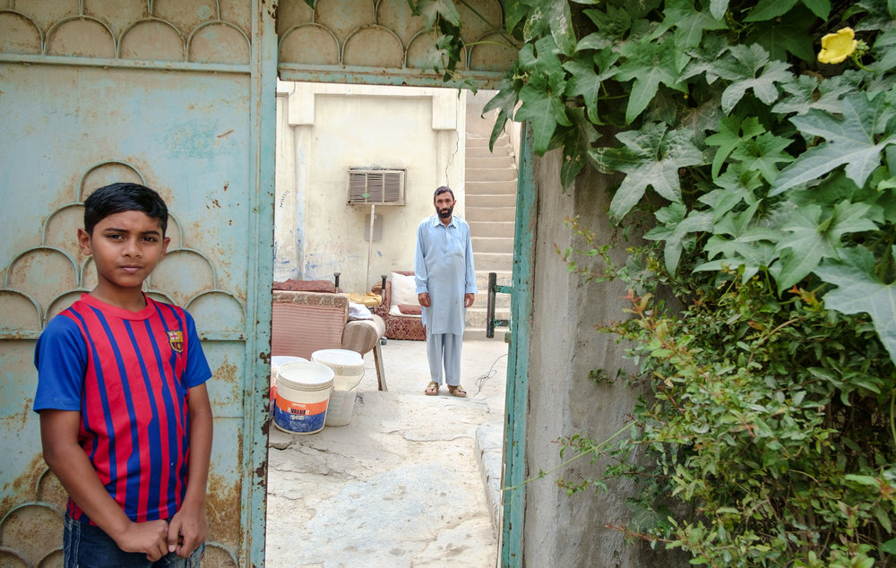A boy and his neighbor are seen in the old Musheireb neighborhood of Doha. Much of this neighborhood has been torn down, and the residents forcibly removed, in order to build the New Msheireb development. Qatar is in a race to revitalize and modernize in time to host the 2022 FIFA World Cup.