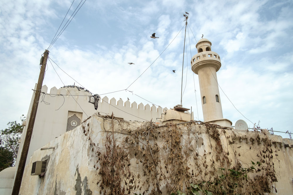 A mosque is seen in the old Musheireb neighborhood of central Doha. Much of this neighborhood has been torn down, and the residents forcibly removed, in order to build the New Msheireb development. Qatar is in a race to revitalize and modernize in time to host the 2022 FIFA World Cup.
