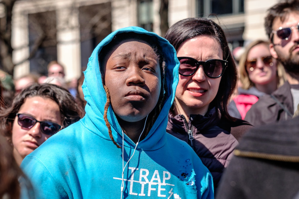 "Ty'Shanna Johnson, a high school student from Washington, DC is seen listening to speakers at the March for Our Lives Rally on Saturday, March 24, 2018 in Washington, DC. ""I'm here to help as much as I can. I hope to stop gun violence, because I grew up in a neighborhood where I witnessed people dying and all that. I lost a few friends. I lost my best friend. Lost everybody that I really was close to. I don't want everybody else to go through that. So I'm here to support as much as I can."""
