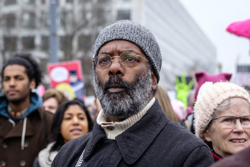 A man listens to speakers at the first-ever Women's March on Washington on Saturday, January 21, 2017. It is estimated that over 500,000 marched, and well over 1 million people world-wide. People came together to proclaim unity and to stand firm on the principles of human rights.