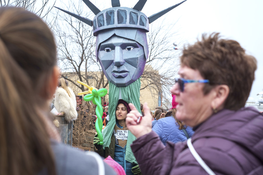 A woman is seen in a Statue of Liberty costume at the first-ever Women's March on Washington on Saturday, January 21, 2017. It is estimated that over 500,000 marched in today's march, and well over 1 million people world-wide. People came together to proclaim unity and to stand firm on the principles of human rights.