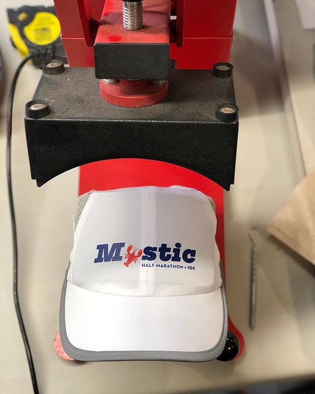 Screen printed hat transfers being pressed this morning for HMF Events / Mystic Half Marathon. • • • #screenprinters #screenprinting #ink #merch #hats #transfers #mystic #connecticut #lobster #marathon #running #10K #5K #race #roadrace