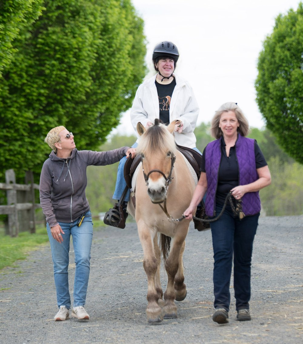 Jeanne Rogalin leading Norwegian Fjord Horse, Minnie during an Adaptive Riding Lesson.   photography by: AbigailThomasNJ