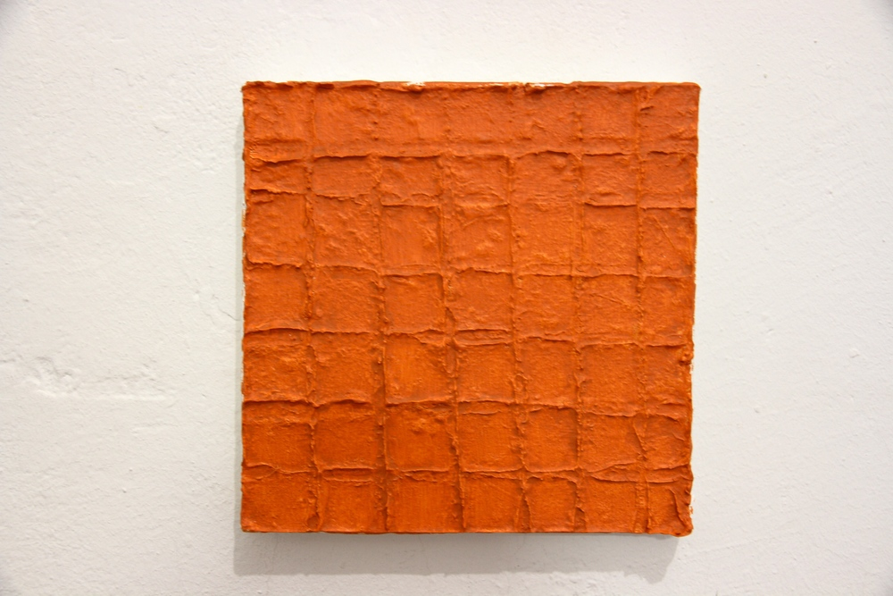 George Leo Sanders.     Adobe (cheetos),    2014. Celluclay and acrylic on canvas.  Photo credit: Candice Strongwater