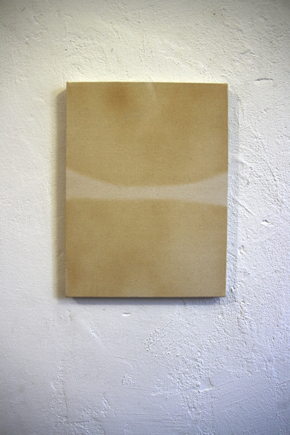 Luther Kroman    Tan Lines,    2014 Tanning spray on canvas Photo credit: Candice Strongwater