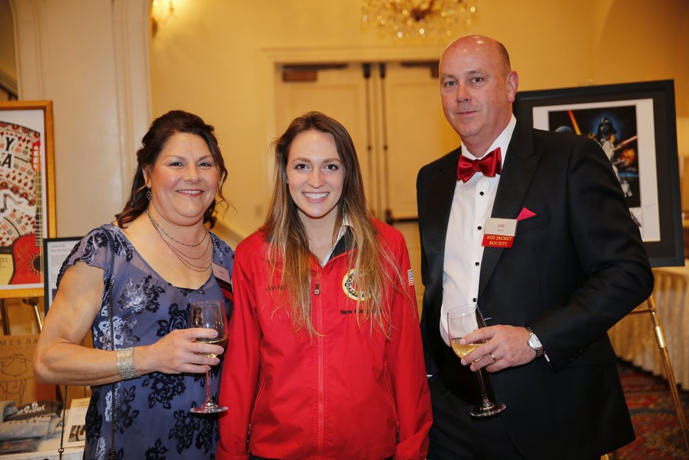 Kim Army and her husband Joe Army with AmeriCorps member Jordan Morell
