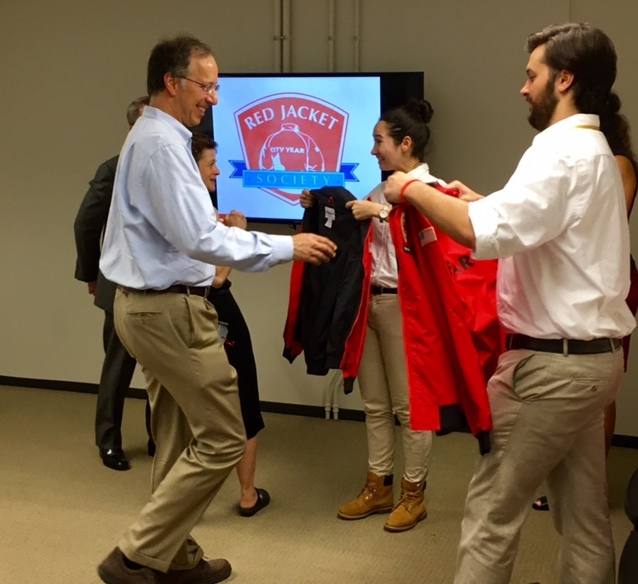 Jeffrey Weissglass and Jeannie Affelder receiving their Red Jackets
