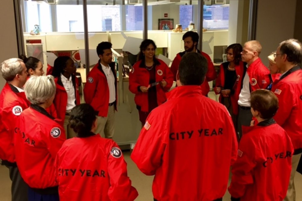 RJS Members and AmeriCorps members in a Strong Circle during the ceremony