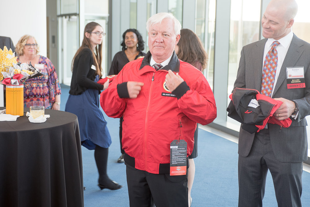 Jim Schoff receives and dedicates his red jacket