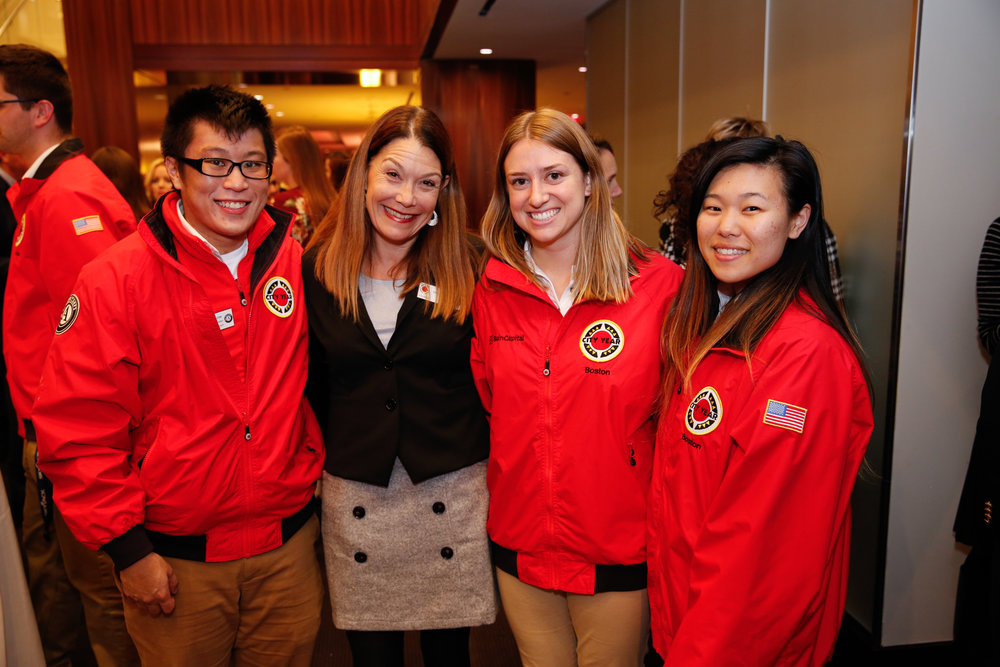 City Year Columbia RJS Chair, Shelley Canright, and City Year Boston AmeriCorps members Gary Chow, Becca Ebbot, and Jenna Kim at the Bain Capital Welcome Reception