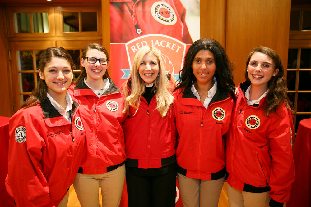 National RJS Chair, Sandy Edgerley at the RJS Jacket Dedication Reception with City Year Boston AmeriCorps members serving on the team supported by the Edgerley Family (from left to right) Reilly Simoneau, Jenny McInerney, Sandy Edgerley, Kendra Ford, and Jess Kenny