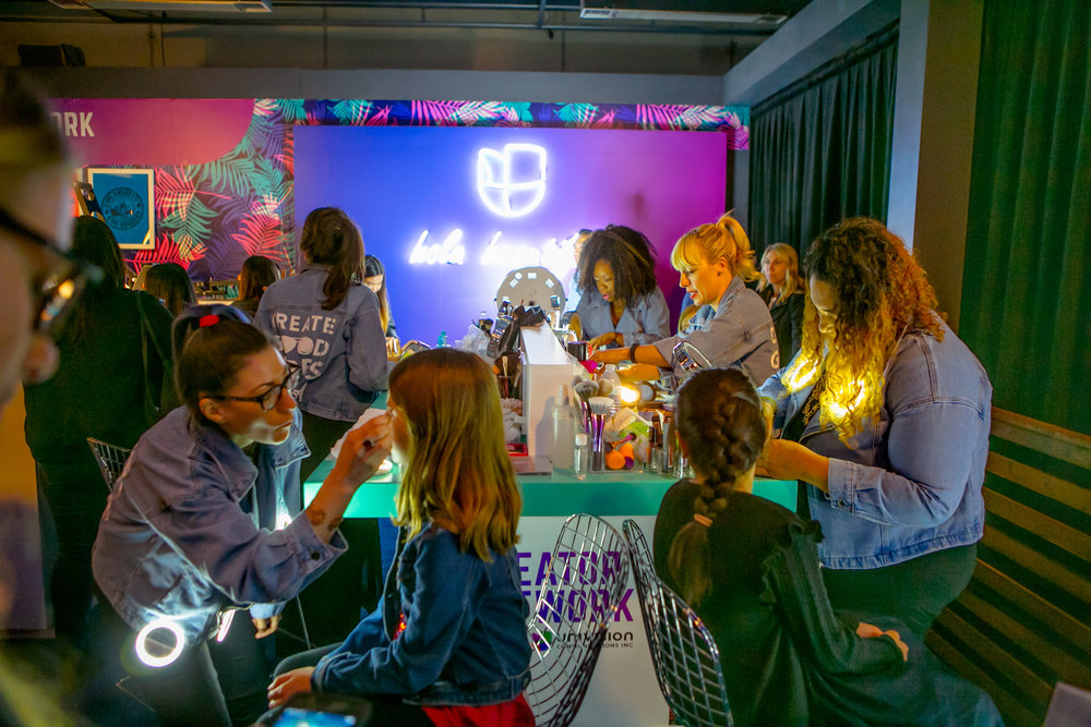 Spring Break guests receive makeovers and custom t-shirts at Univision's booth