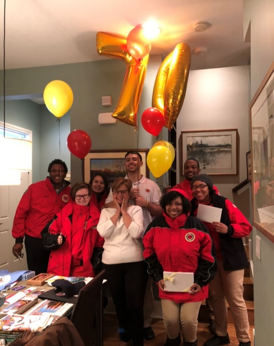 City Year AmeriCorps Members, including Patric (top right), celebrating Anne's (center) birthday