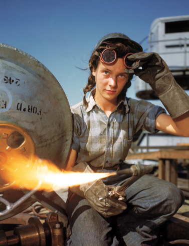 joehillsthrills :      greatestgeneration :      A welder at a boat-and-sub-building yard adjusts her goggles before resuming work, October, 1943. By 1945, women comprised well over a third of the civilian labor force (in 1940, it was closer to a quarter) and millions of those jobs were filled in factories: building bombers, manufacturing munitions, welding, drilling and riveting for the war effort.      Bernard Hoffma—Time & Life Pictures/Getty Images   Read more:  http://life.time.com/history/world-war-ii-classic-photos-from-the-20th-centurys-defining-conflict/#ixzz2ga3Kp0mp      Can't for the life of me say why I think this image is so cool, or so quintessentially American. I wonder if this woman knew, the moment the camera snapped, what an utter badass she was.