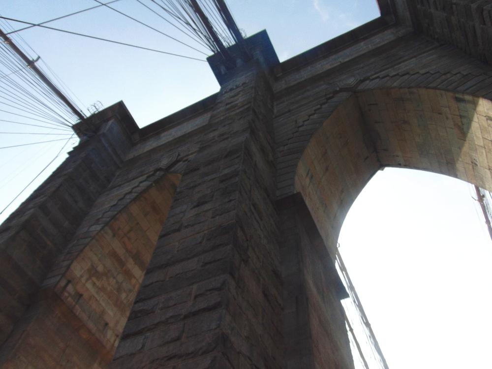 Wondering-Through-New-York-Brookyln-Bridge-Archway.JPG