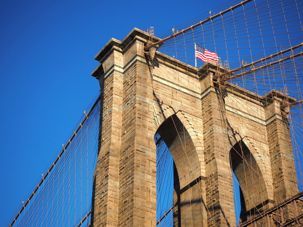 Wondering-Through-Visit-New-York-Dumbo-Brooklyn-Travel-Blogger-Brooklyn-Bridge-Blue-Skies.JPG