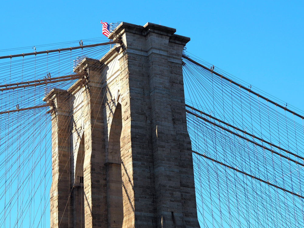 Wondering-Through-Visit-New-York-Dumbo-Brooklyn-Travel-Blogger-Brooklyn-Bridge-Blue-Sky.JPG
