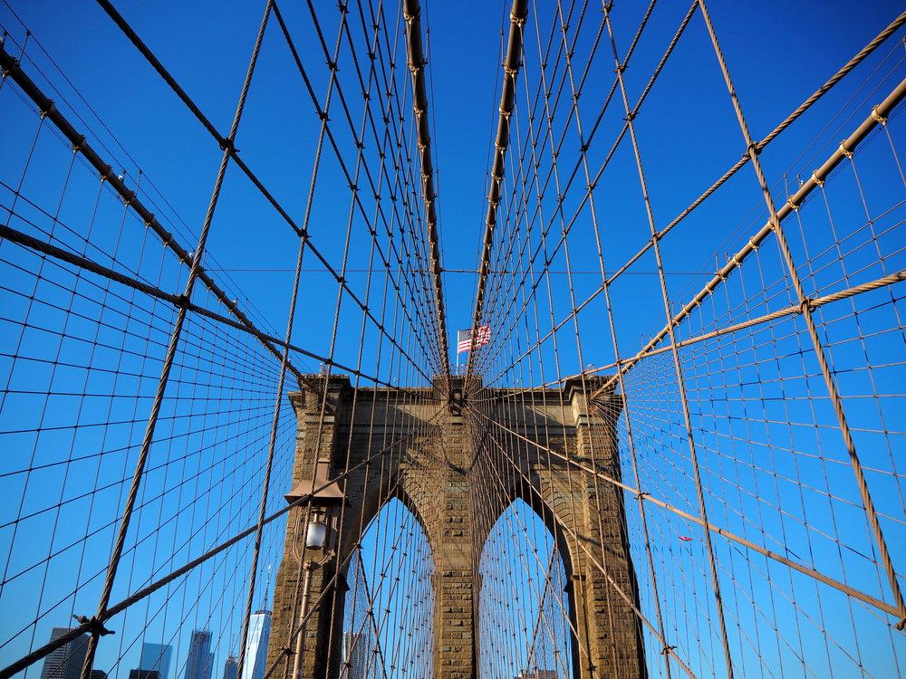 Wondering-Through-Visit-New-York-Dumbo-Brooklyn-Travel-Blogger-Brooklyn-Bridge-Blue-Sky-Walk.JPG