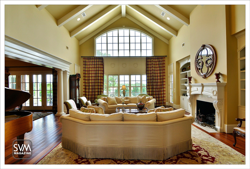 The formal living room features 26' ceilings & vast windows that allow the flow of natural light. The custom wood work makes this home stand outfrom the rest. Living room opens to spacious dining room.