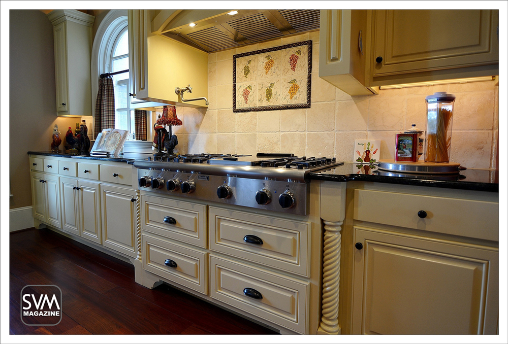 Gourmet kitchen equipped with custom cabinets and under cabinet lighting, stainless steel appliances, double ovens, and Thermador 6 burner professional range. The kitchen is open with two 10' Granite Islands, granite counters,built-in sub zero refrigerator & freezer, granite fireplace with custom mantel, and ample cabinet space.