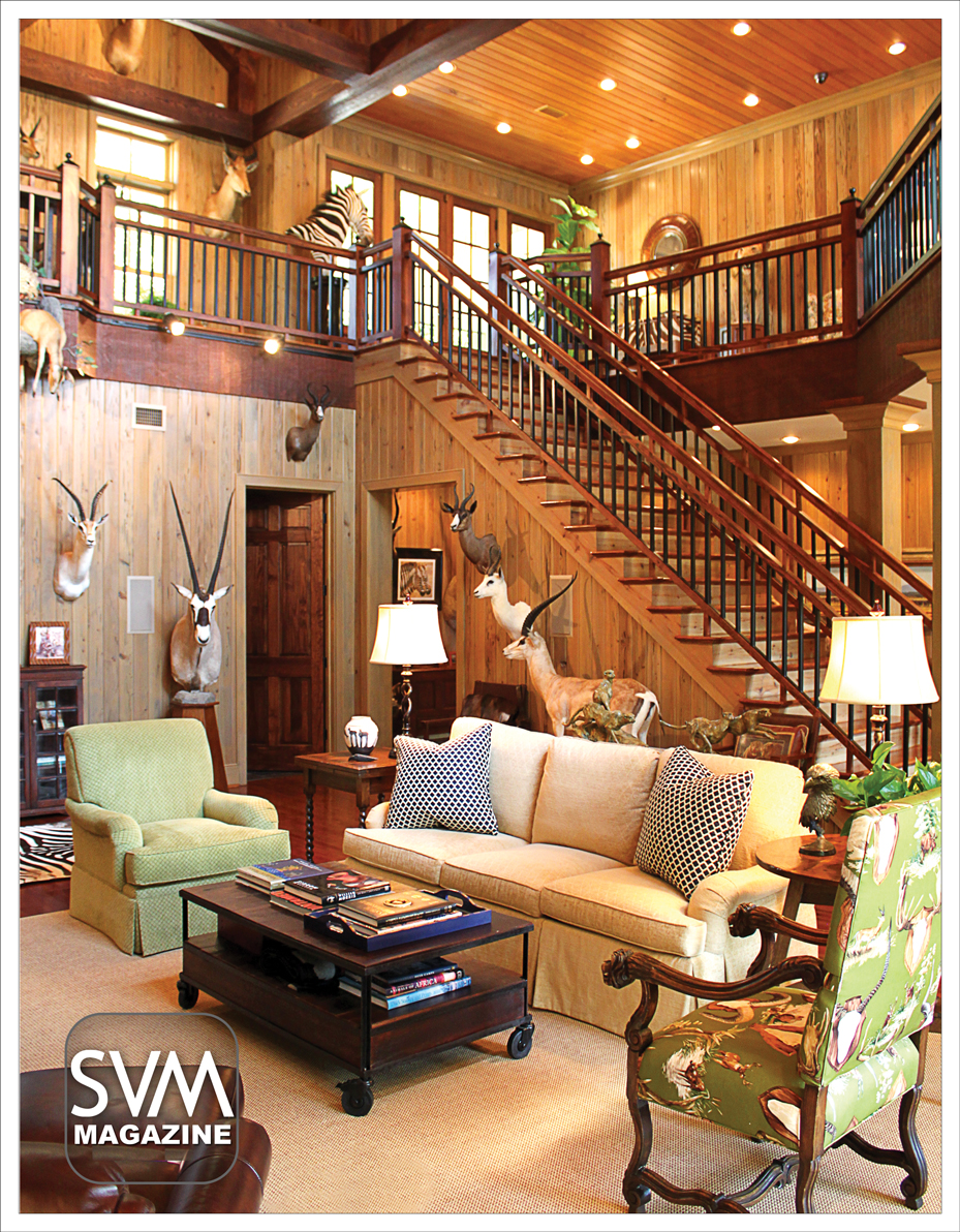 In charge of renovating this magnificent space, Howard Bantlett of HoBart Builders, knew that Carl needed ample space to house his many big game trophies. This two story trophy room, with wood paneled walls, exposed beams, and recessed lighting, does just that.