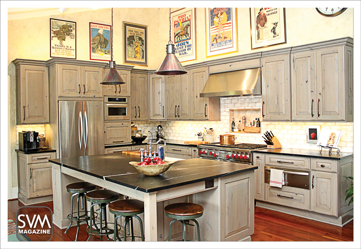 With the help of interior designer Ashley Holt, the Savory's kitchen reflects a more contemporary, industrial look. The cabinets (provided by Highland Design Gallery in Atlanta) are the perfect complement to the stainless steel appliances – provided by Daniel Appliance. The look is made complete with vintage bar stools by Restoration Hardware, island lamps from Uttermost Lamps, kitchen fixtures by E & E Plumbing, and original posters from Carl's own war collection adorning the walls.