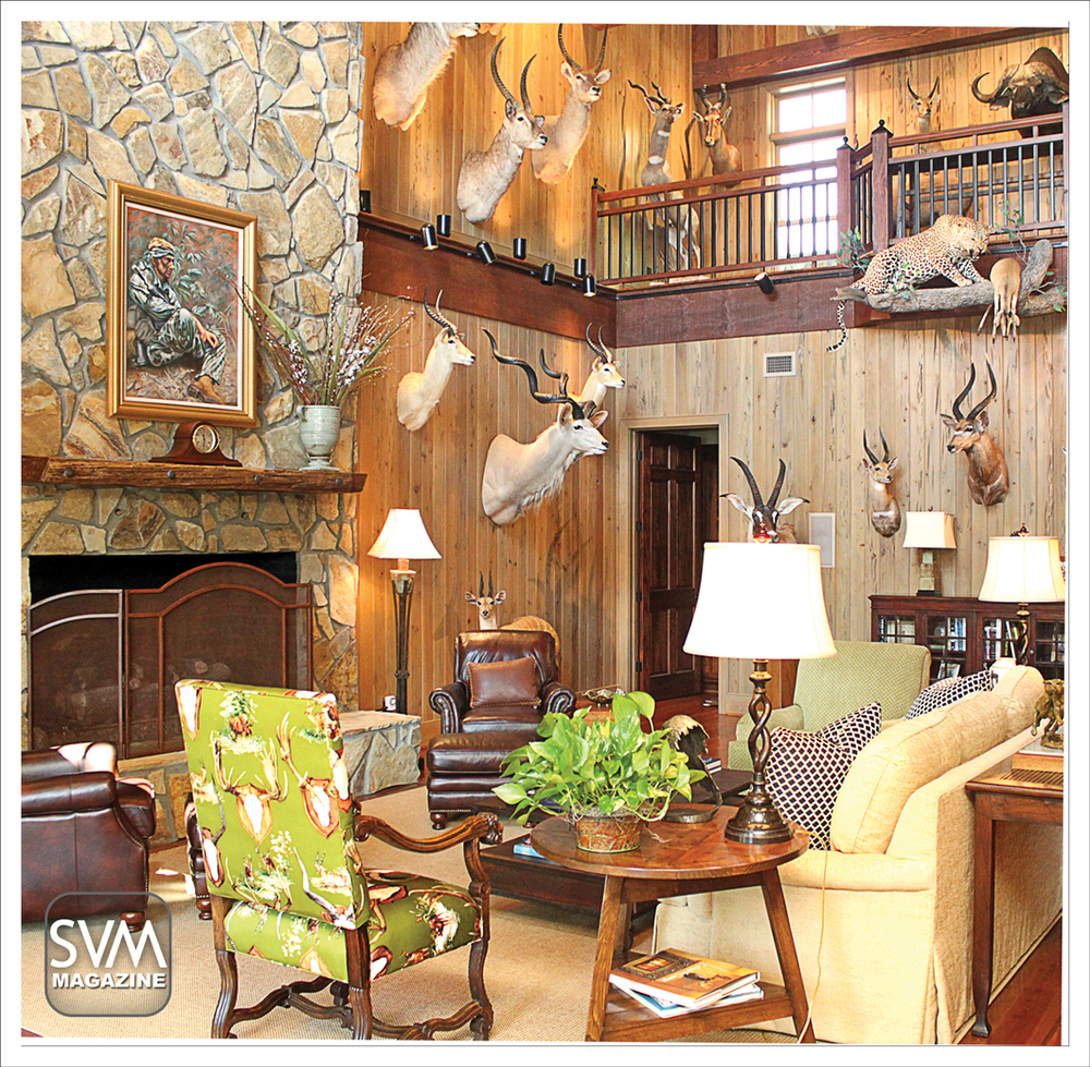 A view of the trophy room shows off a beautiful painting of Dr. Savory during the Vietnam War, given to him by one of his patients, over the beautiful stone fireplace. With warm, neutral colors this room serves as the perfect man cave for Dr. Savory to sit and relive his numerous hunting excursions.