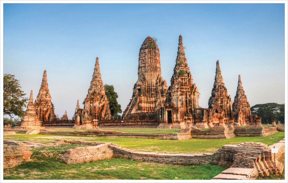 "Just 50 miles north of Bangkok is the old capitol of Ayutthaya. The city became Thailand's capitol in the mid-14th century and remained the capitol until the late 18th century. About the time that Americans were tossing tea into Boston harbor, the Burmese attacked and sacked Ayutthaya. The Ayutthaya period is looked on by many as the time when much of what is now thought of as ""Thai style"" was developed. In temples, this is when you see a marked transition from the Khmer style prangs to the bell shaped chedi. While Sukothai further north is seen as the birth of the Thai kingdom, Ayutthaya is seen today as its high point. Around Ayutthaya are signs of the Japanese, French, Dutch and Portuguese traders that came to the Thai court."