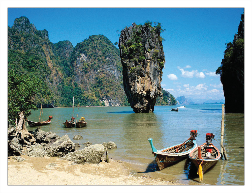 With turquoise bays peppered with craggy limestone rock towers, brilliant-white beaches and tumbledown fishing villages, Ao Phang-Nga is one of the region's most spectacular landscapes. Little wonder then that it was here, among the towering cliffs and swifts' nests, that James Bond's nemesis, Scaramanga (The Man with the Golden Gun), chose to build his lair. Wanted assassins with goals of world domination would not be recommended to hide out here nowadays, since the area is swarming with tourists in motorboats and sea kayaks nearly year-round. Much of the bay, and some of the coastline, has now been incorporated into the Ao Phang-Nga National Marine Park.