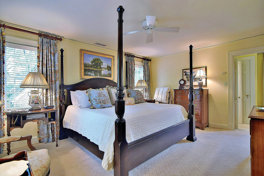 One of three bedrooms, the master bedroom is a haven at the end of a long day. The antique-style four-post bed was purchased from EJ Victor.
