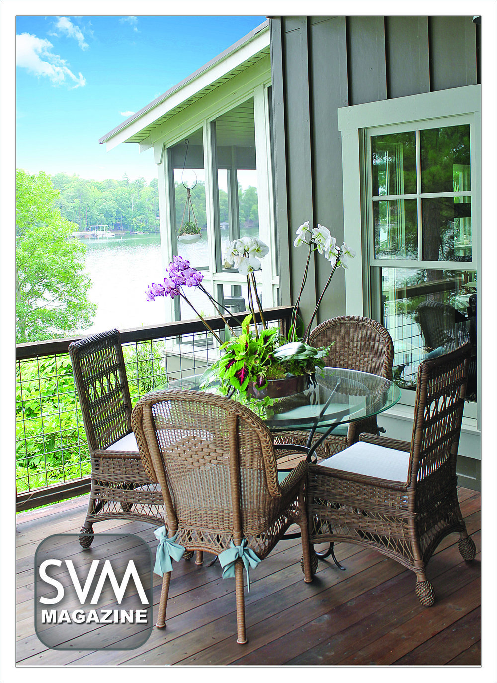 With abundant views of Lake Harding, the Peek's refurbished side porch is the perfect place for a family breakfast. The Peeks dress the table with orchids and surround it with four wicker chairs for seating. With a hogwire railing, one's view of the lake is unobstructed.