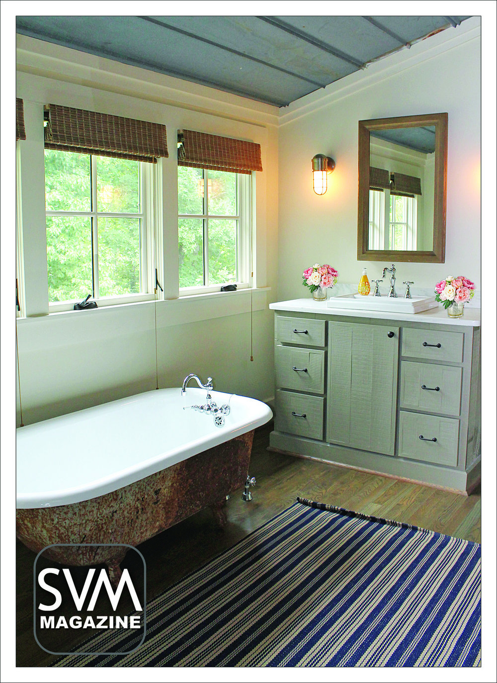 The upstairs bathroom features a claw foot tub and a custom made marble top vanity which offers views of the front of the house.