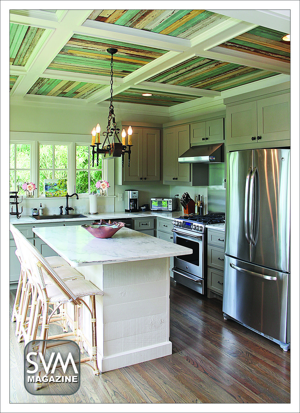 The beautiful expanded kitchen is Rachael Peek's favorite part of the house, and it's clear why. Originally an extra porch, the family enclosed the porch to create a large kitchen. The fixtures, from Ferguson Enterprises, break up the rustic pieces with modern elements. The off white cabinetry, by Braden Berendt, shows off the tall, reclaimed wood ceilings by Tim Gregory. The rustic light fixture, by The Big Chandelier, makes the marble counter tops, fabricated by Joe Waller, the belle of the ball. The stainless steel appliances are all GE from Harvey's. The kitchen bar stools from Serena & Lily offer a casual seating area for the family.