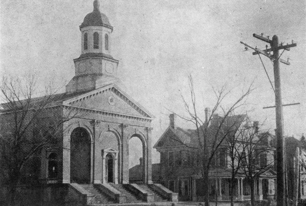 The First St. Paul Church in Columbus, built 1859 with L. Pierce as first pastor. The church was destroyed by lightening in 1901.
