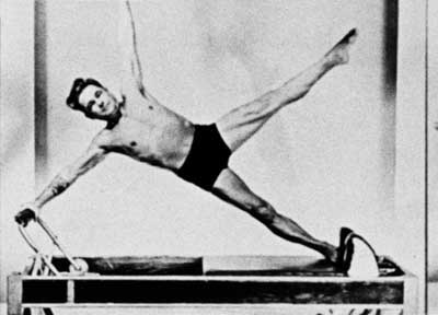 Joseph Pilates on his apparatus
