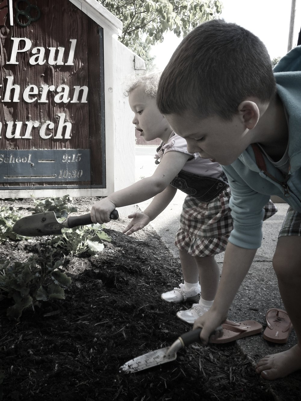 Kids at Sunday School planting flowers in front of church.jpg