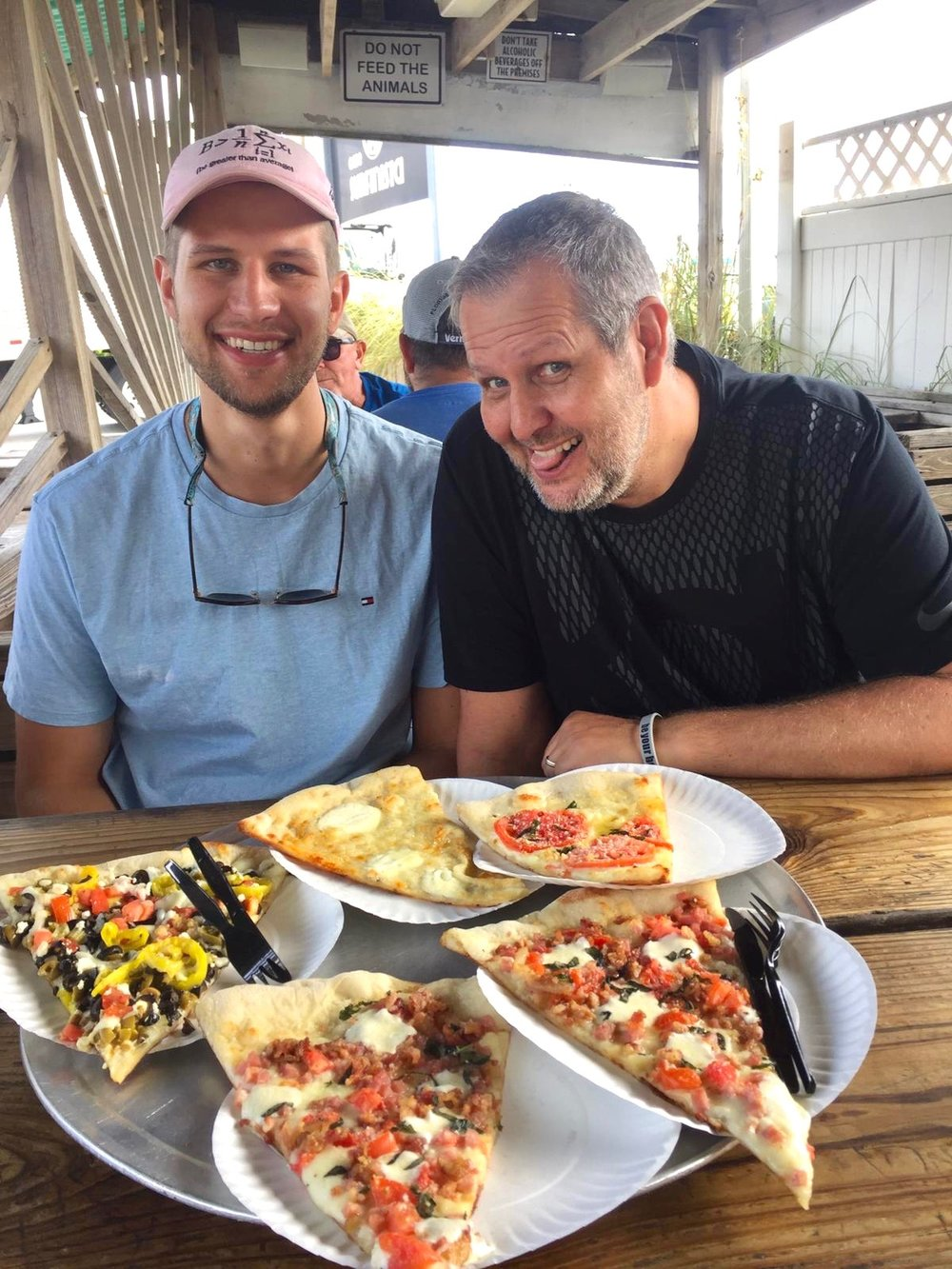 andrzej and his father, Mariusz Kolaczewski, enjoying lunch at  The Original Bizzarro Famous NY Pizza  in indialantic, florida.